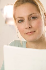 Woman Holding Documents