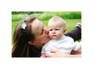 mom kissing little baby