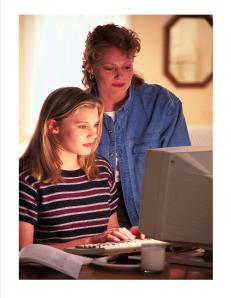mother and daughter on computer