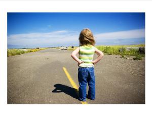 girl looking down road