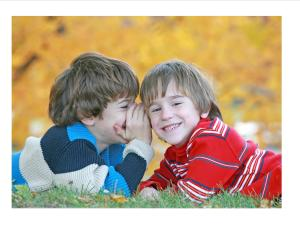2 boys whispering